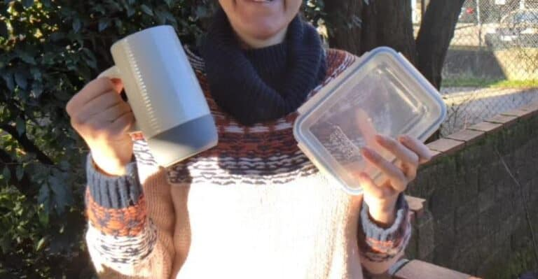 Woman holding reusable containers for food and beverage.Goin Green New WestProject